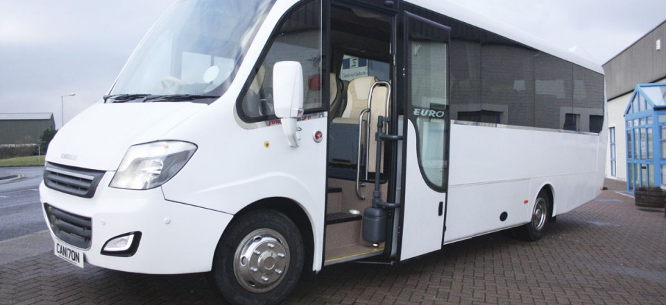 The front entrance of the Cannon Euro Variant Luxor coach  with powered plug door. New coach for sale Ireland